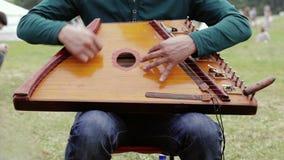 Folk musician playing gusli stock video footage