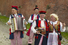 Folk Musician playing at the Wawel Hill in Krakow Stock Photos