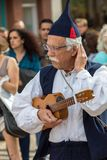 Folk musicians and dancers performing on the Avenida Arriaga  in Funchal on the Madeira Island, Portugal. Funchal, Portugal - April 19, 2018:  Folk musicians and royalty free stock images