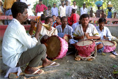 Folk Musicians performing. A group of musicians performing at the bank of river Ganga on the occasion of Chat festival at Kolkata Stock Images