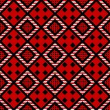 Folk ornament hand drawn seamless pattern. Abstract tribal texture. Black, white rhombus on red decorative background. Ethnic embroidery pixel drawing. Textile royalty free illustration