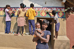 Folk Painting. Young girls and boys doing painting during Bandna festival in Purulia-West Bengal Stock Photography