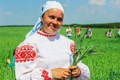 Folk rituals yield improvements in the Gomel region of the Republic of Belarus in 2015. Dressed in traditional costumes, the villagers, including women and Royalty Free Stock Photo