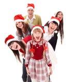 folk santa för hatt för barngrupp lyckligt Arkivbild