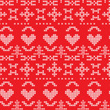 Folk seamless pattern with hearts and snowflakes Royalty Free Stock Photo