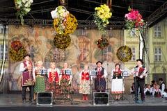 Folk singers Stock Image