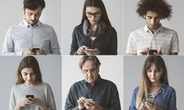 Folk som använder mobiltelefonen fotografering för bildbyråer