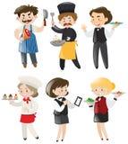 Folk som gör olika jobb i restaurang Royaltyfri Bild