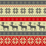 Folk style Christmas seamless pattern. With deers  and ornament Royalty Free Stock Photo