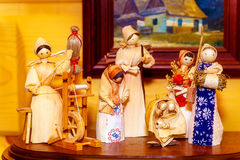 Folk style traditional handmade figures made from natural materials doing chores and crafts. Folk style traditional handmade figures made from natural materials stock image