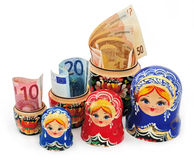 Folk toys Russia and the euro money Stock Photography