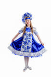 Folk traditional carnival costume. Young girl in folk traditional carnival costume, blue and white fluffy skirt Stock Photography