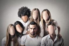 Folk utan framsidor Arkivbild