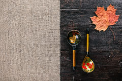 Folk wooden spoons and leaf Royalty Free Stock Photo