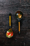 Folk wooden spoons Royalty Free Stock Images