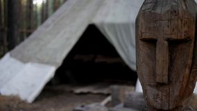 Folk wooden statue. Traditional nomadic yurts, and an old Kyrgyz flag, in Central Asia stock video footage