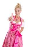 少女装礼服的愉快的年轻白肤金发的妇女在巴法力亚folkart 免版税库存照片