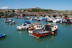 Folkestone Harbour, England. Small boats moored in the harbour at Folkestone in Kent, England Royalty Free Stock Photos