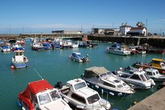 Folkestone Harbour, England. Small boats moored in the harbour at Folkestone in Kent, England Royalty Free Stock Photography