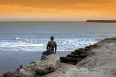 Folkestone Harbour Mermaid Kent UK. Mermaid on Sunny Sands Beach on sunset by Folkestone Harbour Kent UK Royalty Free Stock Photography