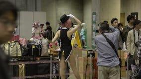 Folket deltar i det Tokyo drömpartiet, en anime- och Manga Cosplay regel arkivfilmer