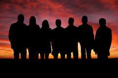 folket silhouettes solnedgång Royaltyfri Fotografi