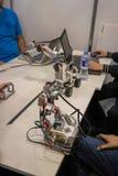 Folket som planlägger robotar royaltyfria foton