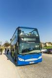 Folket tycker om Munich vid flygtur på flygtur av bussar Fotografering för Bildbyråer