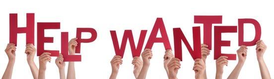 Folkhänder som rymmer röd ordhjälp önskad Royaltyfri Bild
