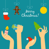 Folkhand som rymmer en julsymbolism och Arkivfoto