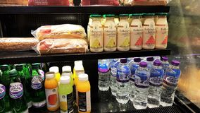 Folkington`s fresh juices and high land mineral water stacked togather in a shelf. stock images