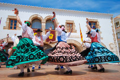 Folklore Dance in Europe. A group of folk dancers perform a medieval dance for tourists in spain, ibiza. Bright sunny day Royalty Free Stock Photos