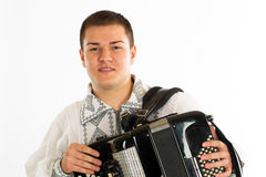 Folklore dressed man with accordion on white background Stock Photo