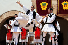 Folklore Festivals in Europe. A group of folk dancers perform a medieval dance for tourists in spain, ibiza. Bright sunny day Stock Image