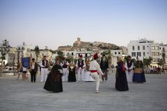 Folklore group performs traditional dance in traditional costume stock image