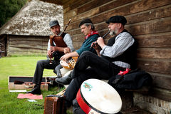 Folklore musicians Stock Images
