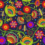 Folklore pattern of flowers. Seamless pattern with ornamental flowers on a dark background Royalty Free Stock Photography