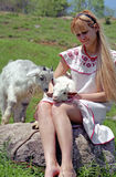 Folklore woman with kid Stock Images