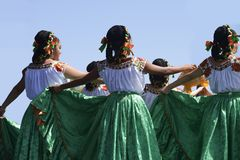 Folkloric dancer. Performs a dance to music with a group of women during the afternoon stock images