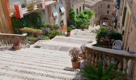 Folkloristic stairs in town. A folkloristic stairs rich of plants and flowers in Corinaldo`s medieval center royalty free stock photography