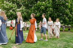 Folklorists with national costumes singing in park Royalty Free Stock Photo