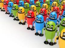 Folkmassa av färgrika robotar Arkivbilder