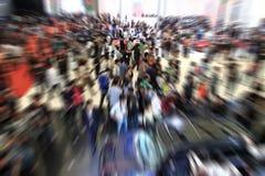 Folkmassa på utställningen. Royaltyfri Foto
