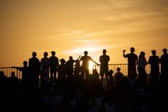 folkmassasolnedgång Royaltyfri Foto