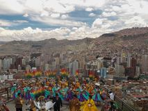 Folkore dance with view over La Paz, Bolivia royalty free stock photo