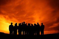 folksolnedgång Arkivfoto
