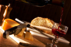 Folksy dinner. With wine, cheese and bread Royalty Free Stock Image