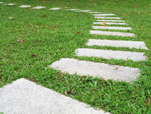 Follow the Blocks. Stepping stones on a field of green grass royalty free stock photography