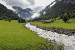 Follow the Creek. (Creek in Switzerland). Creek in Oberland Switzerland, on a summer day Stock Photos