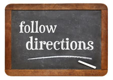 Follow directions blackboard sign Royalty Free Stock Photography